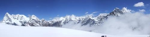 Trekkers dwarfed by the peaks above the Mera La