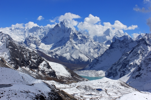The view down to the Chola Tsho (lake) with Ama Dablam coming out of the clouds.