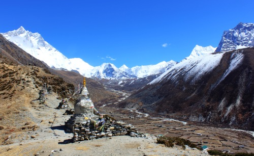 Chortens and Stupas above Dingboche. Island Peak, 6,183 metres sits in the bowl at the head of the valley.