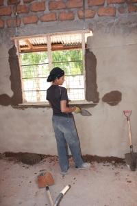 Installing windows into a classroom.