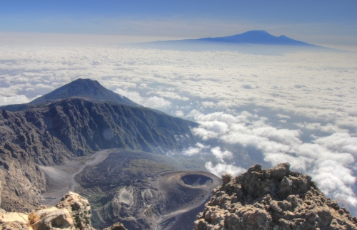 The view from Meru summit with Little Meru, Rhino Point, the Ash cone and Kilimanjaro all visible.